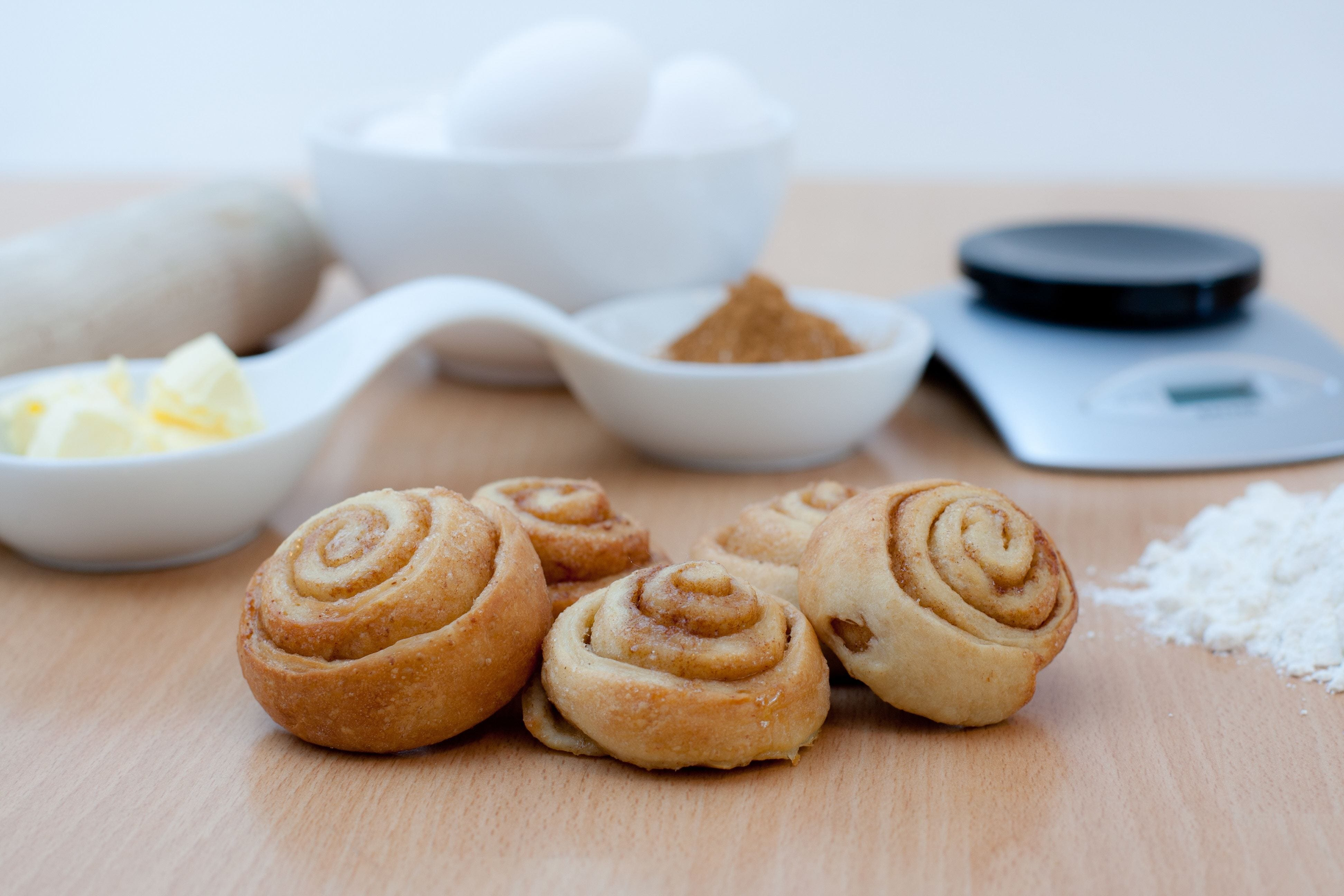 cinnamon rolls on a floured pastry board