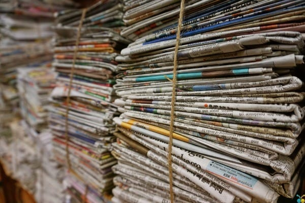 large stacks of old news papers