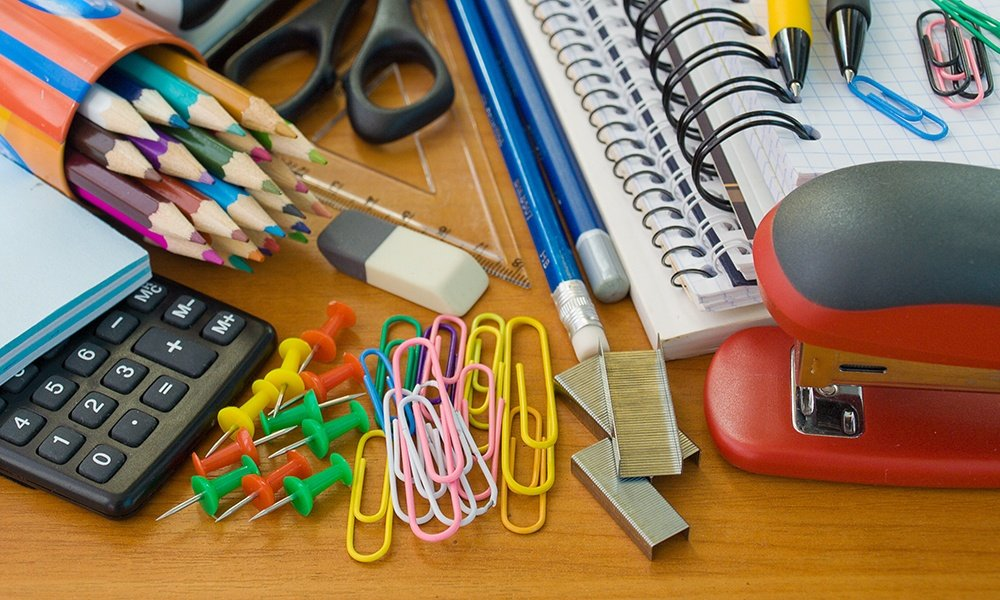 Assortment of office supplies scattered on a desk