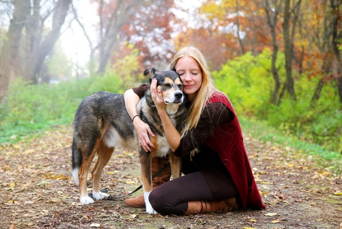 Older dog with young woman