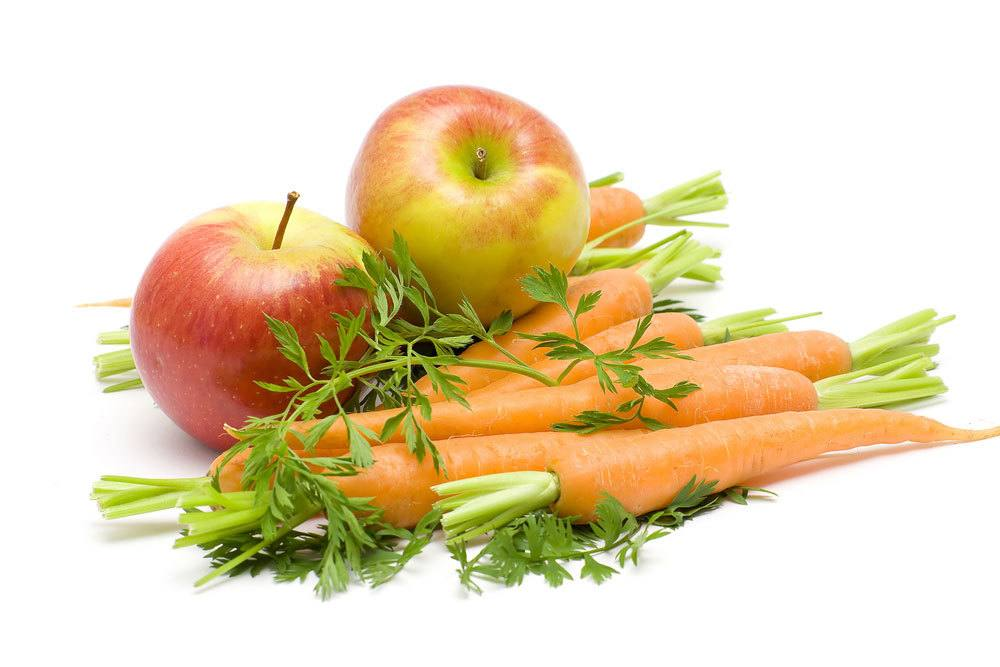 apples and carrots on white background