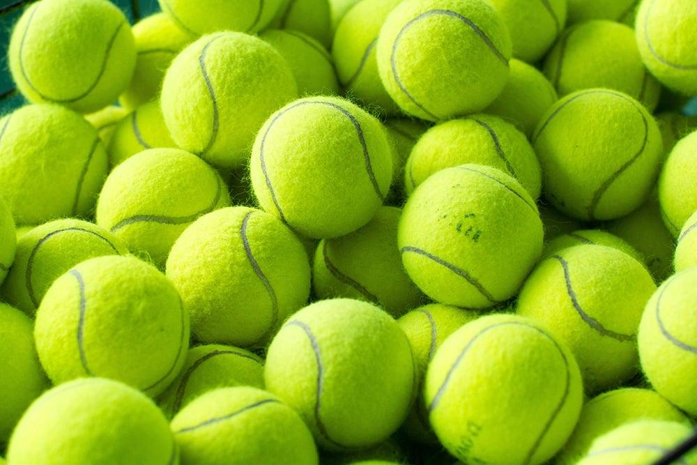 a pile of yellow tennis balls