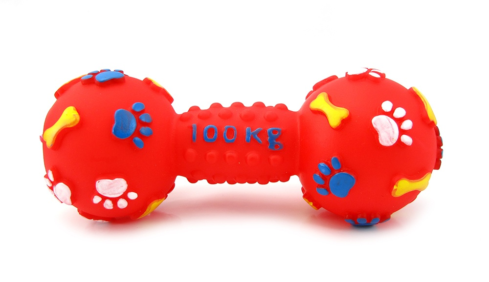 Red rubber bar bell style dog toy with pay prints and bones printed on it