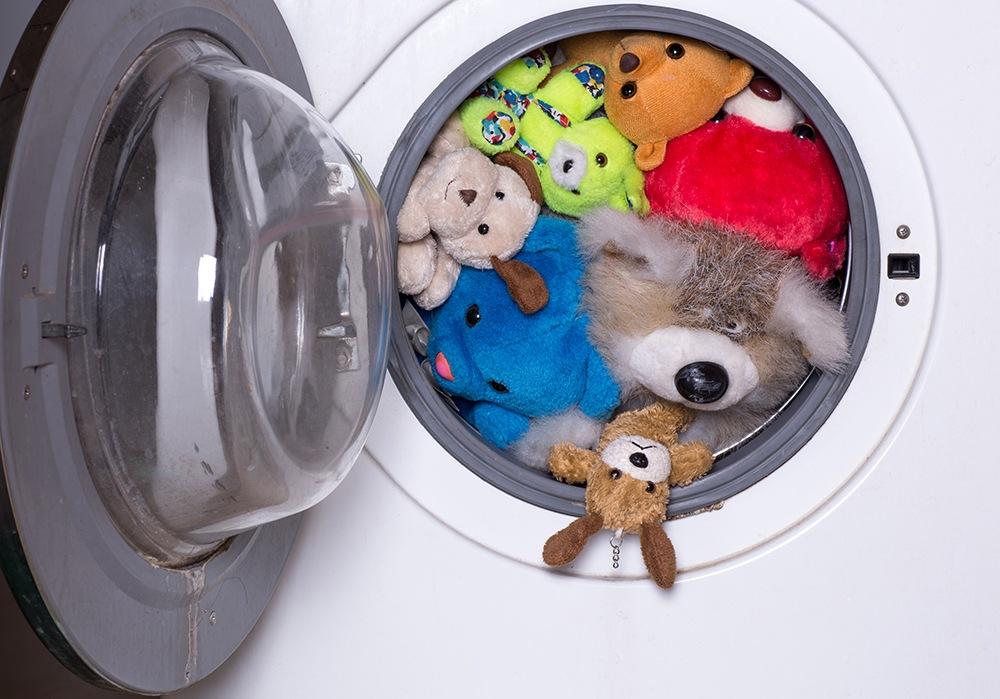 washing machine full of stuffed animals