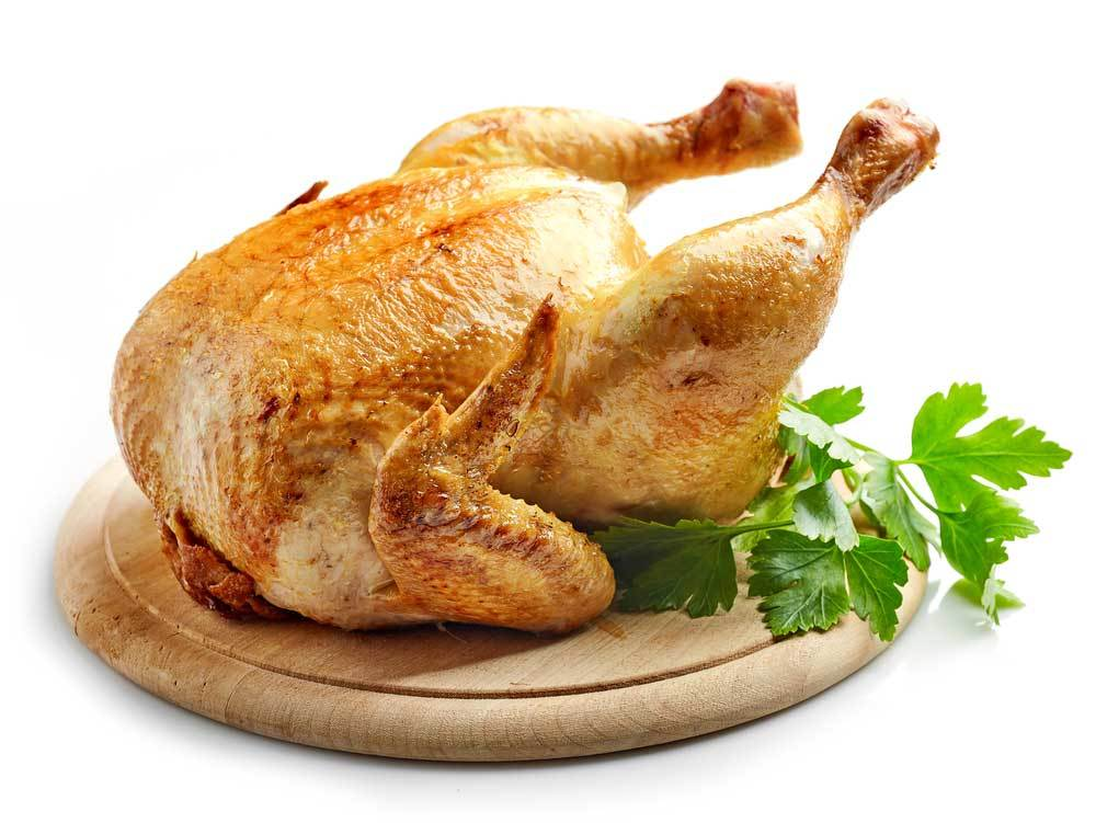 Roasted chicken on a wooden platter