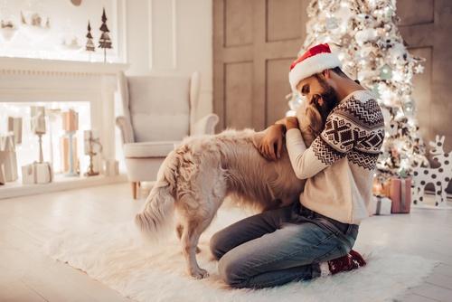 man with dog at christmas