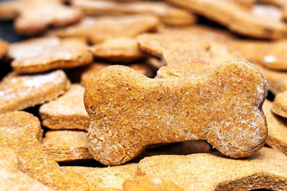 Pile of homemade dog bone shaped dog treats