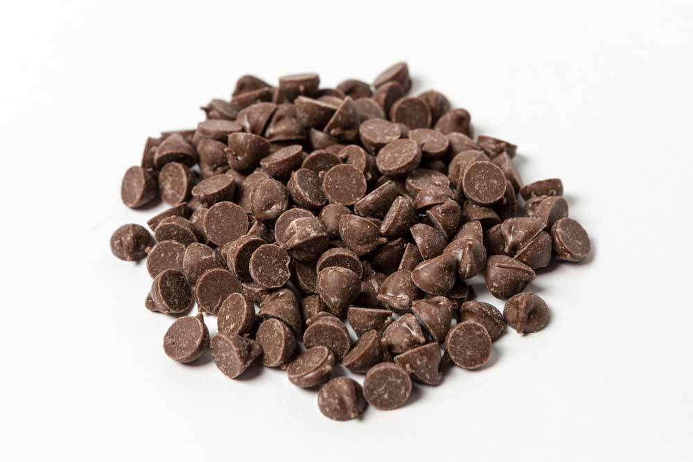 of carob chips on a white background