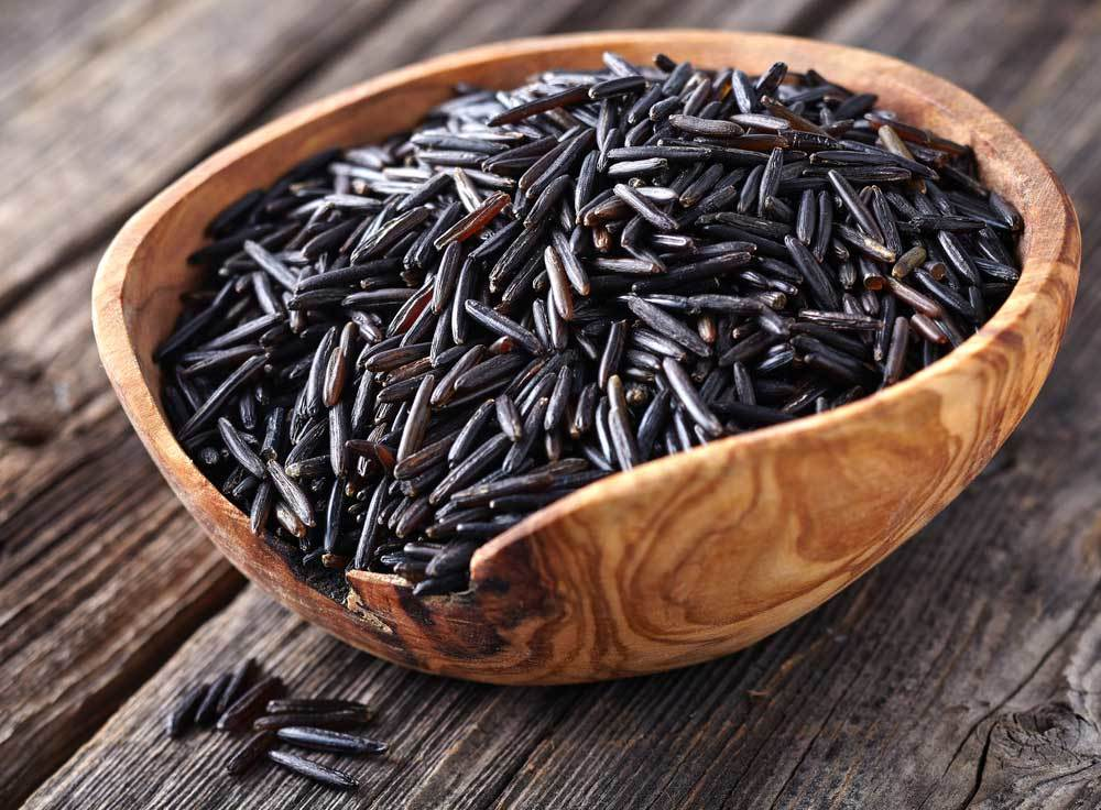 Wild Rice in a wooden bowl on a wooden table