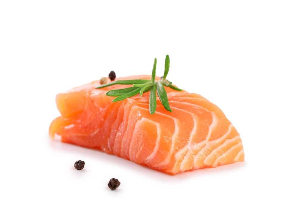 Raw salmon on white background