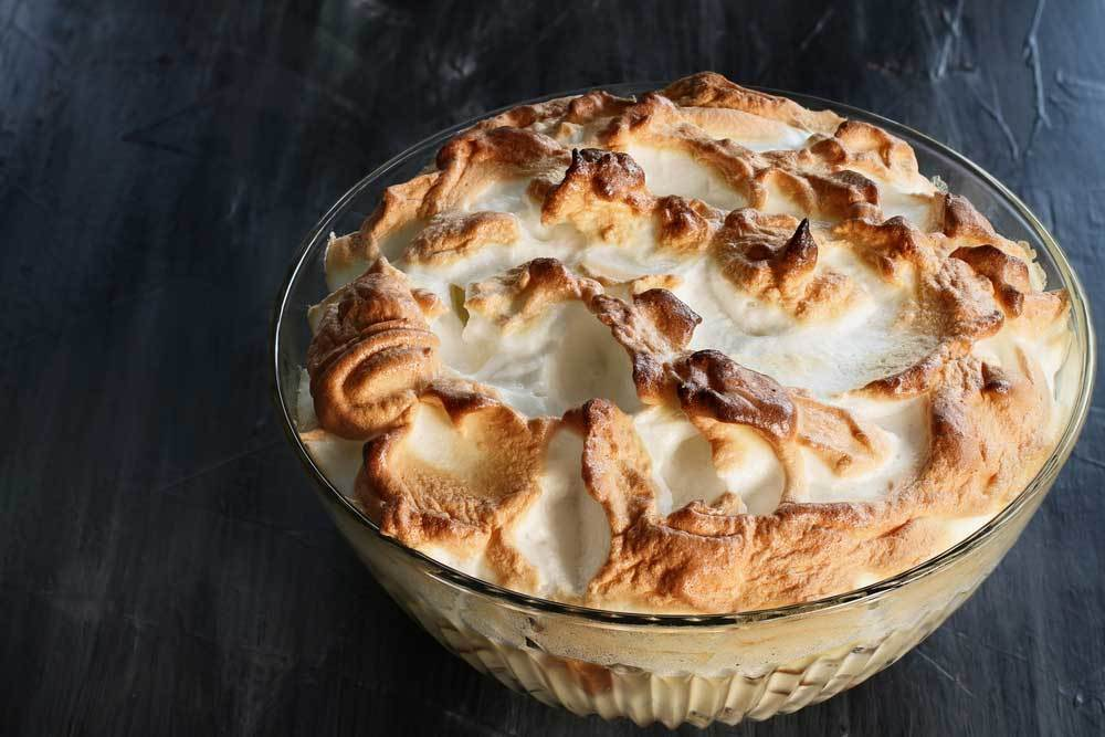 Glass bowl of banana pudding topped in meringue