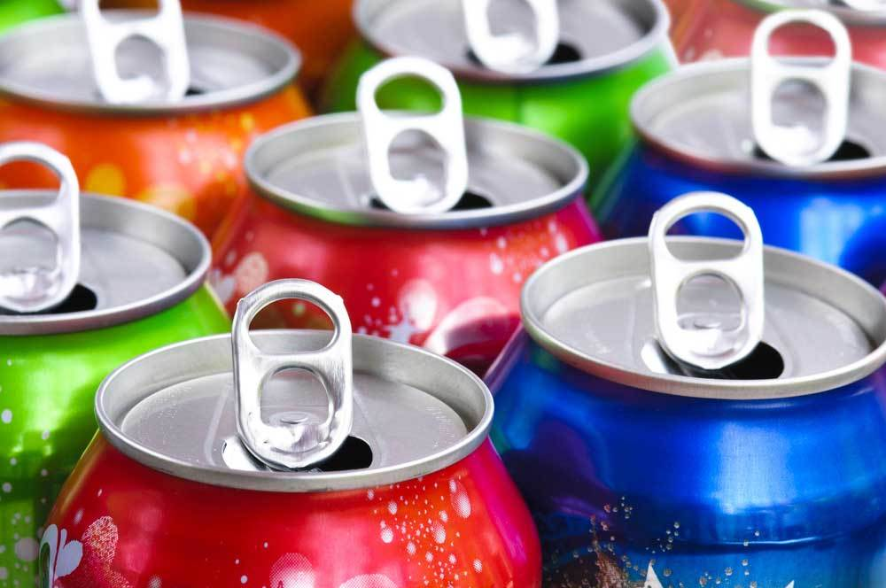 Variety of soda cans tops with tabs open