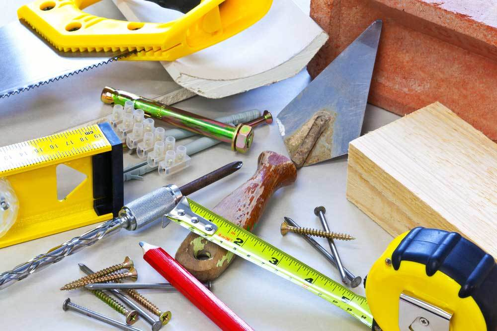 variety of building tools and materials on a white counter