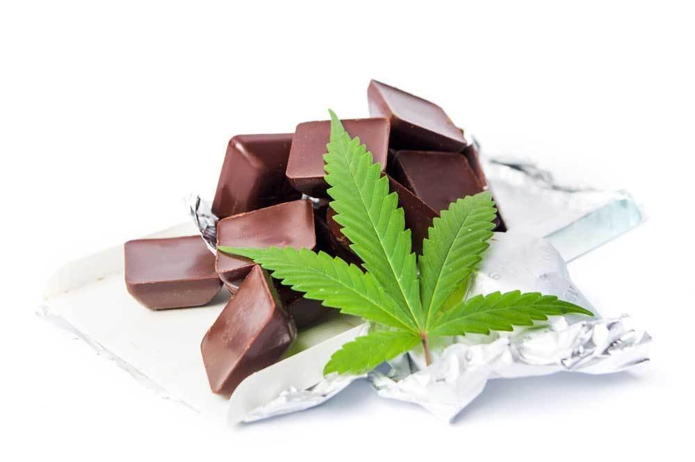 chocolates with a marijuana leaf on a white background