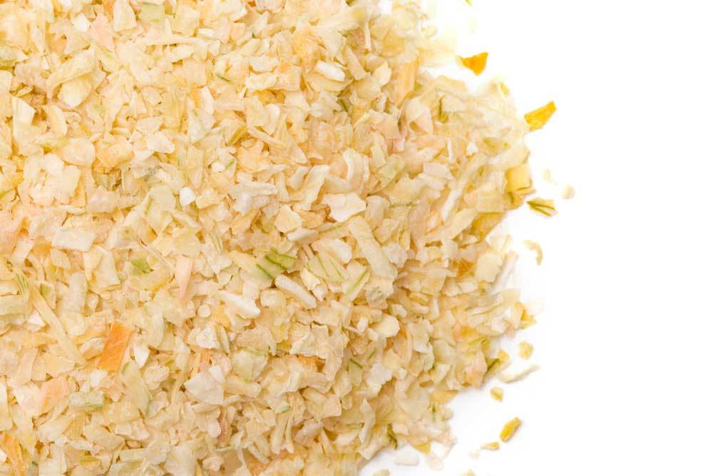 Dried minced onion on white background.