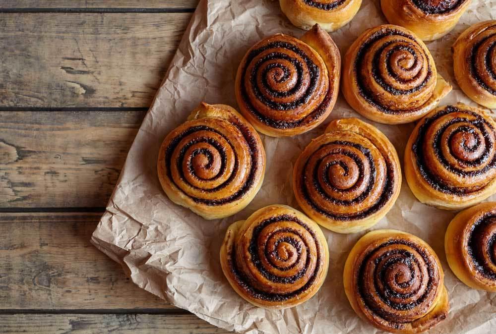 cinnamon rolls on wood tabletop
