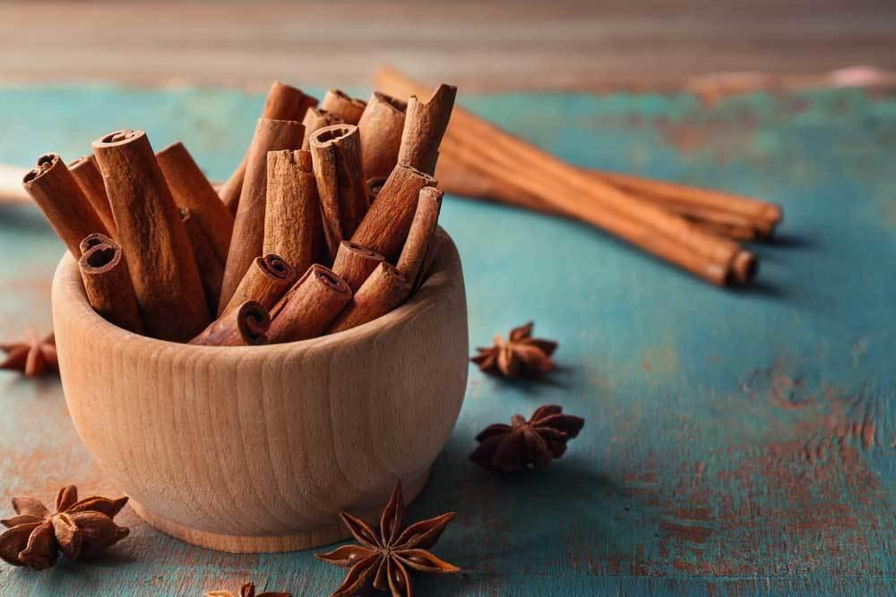 Cinnamon sticks in a wooden bowl