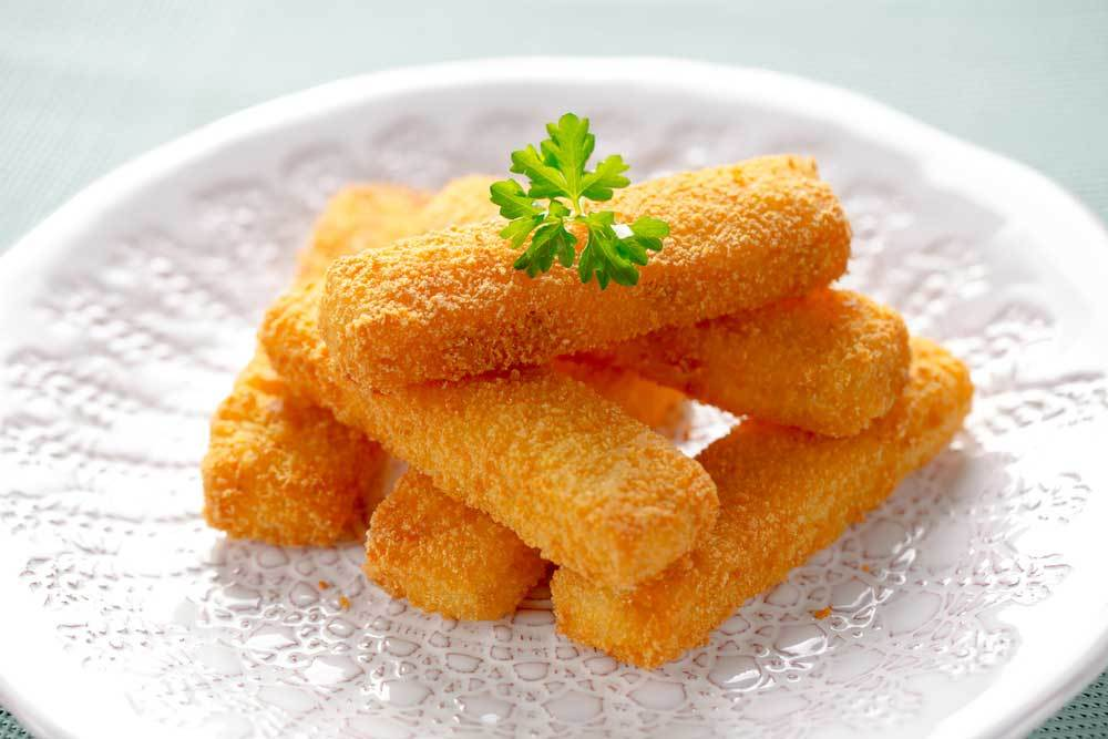 fried fish fingers on a decorative plate