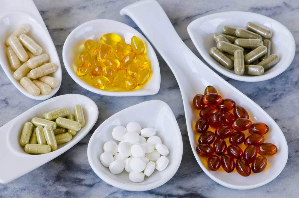 bowls of different dietary supplements
