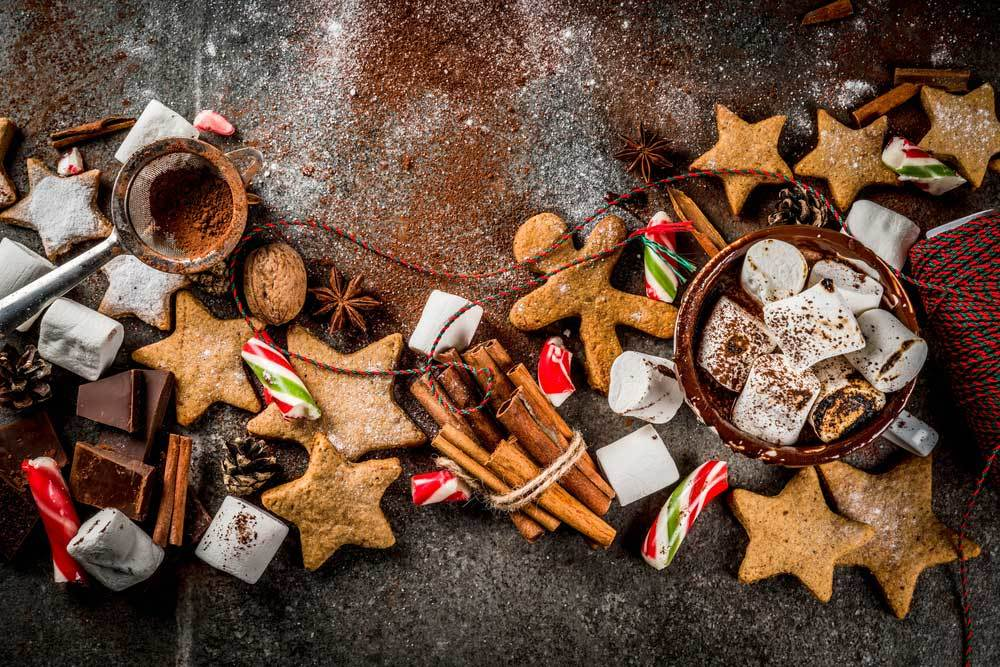random christmas treats and spices on a slate surface