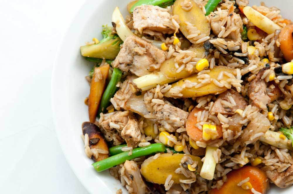 bowl of brown rice with chicken and vegetables