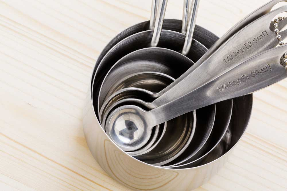 metal measuring cups and spoons stacked.