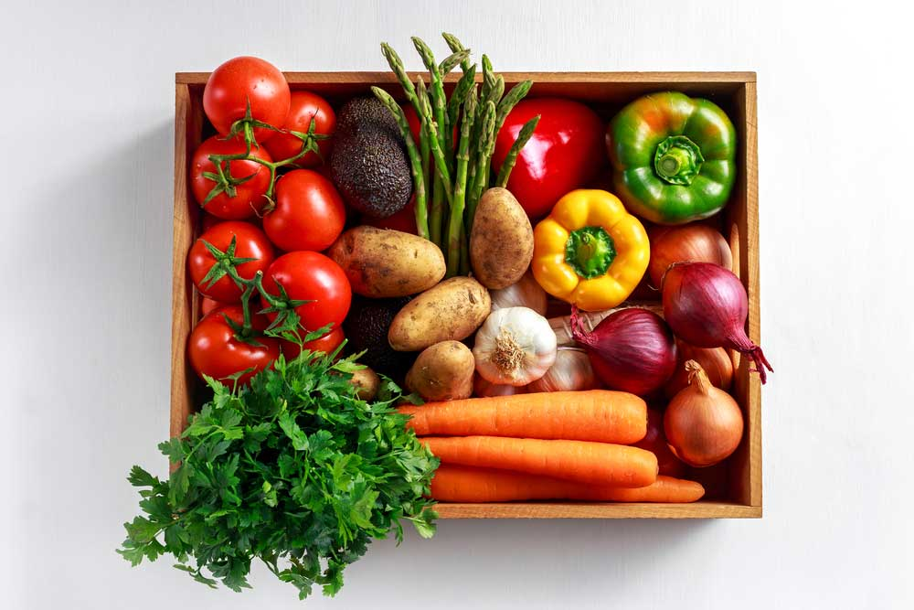 Variety of vegetables in a wooden crate