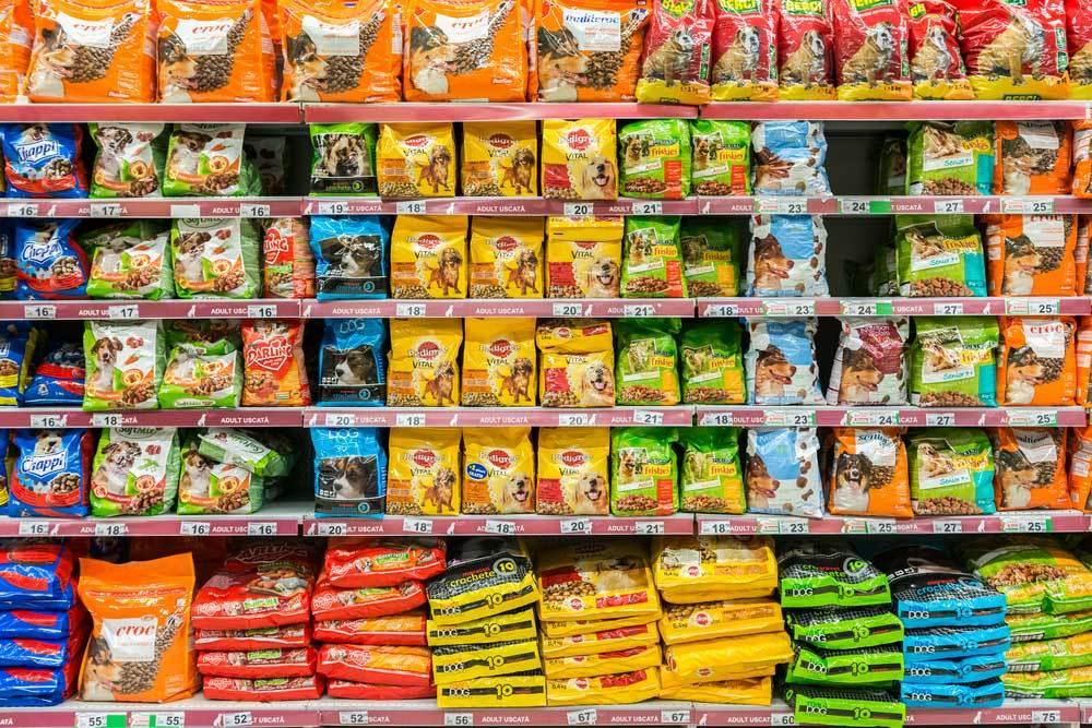Grocery shelves of shelf stable dog food