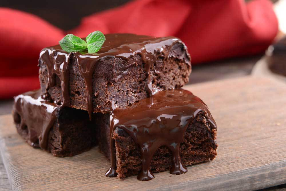 2 brownies topped with chocolate
