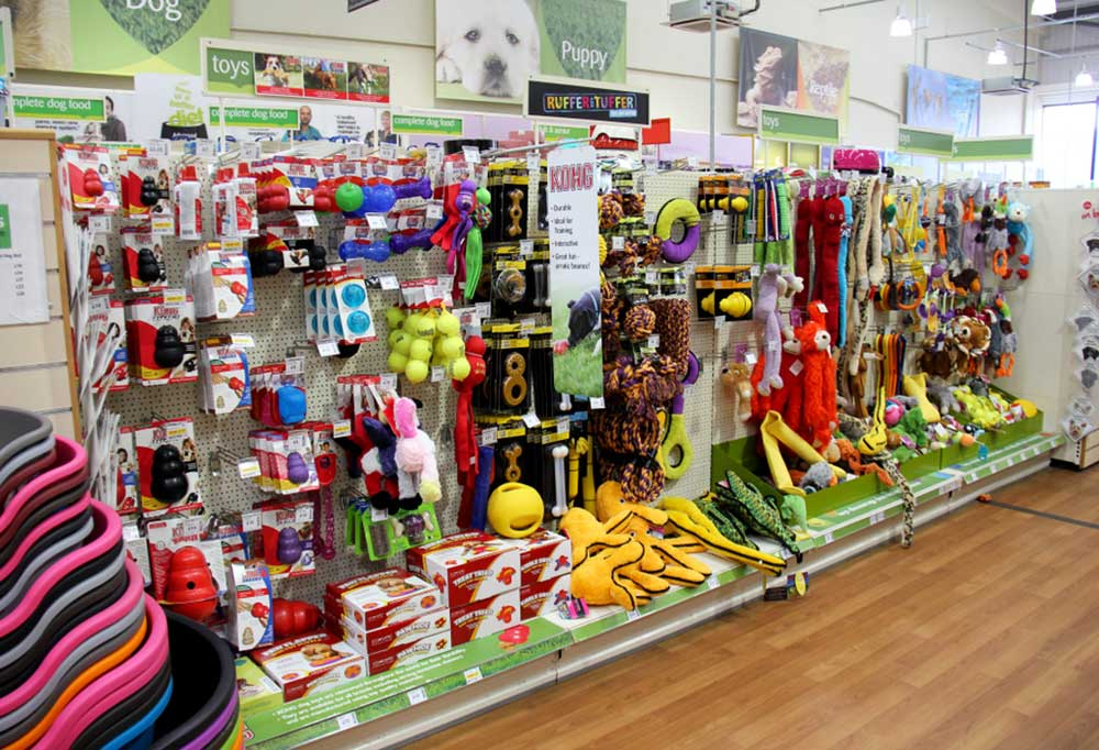wall of dog toys in a pet store