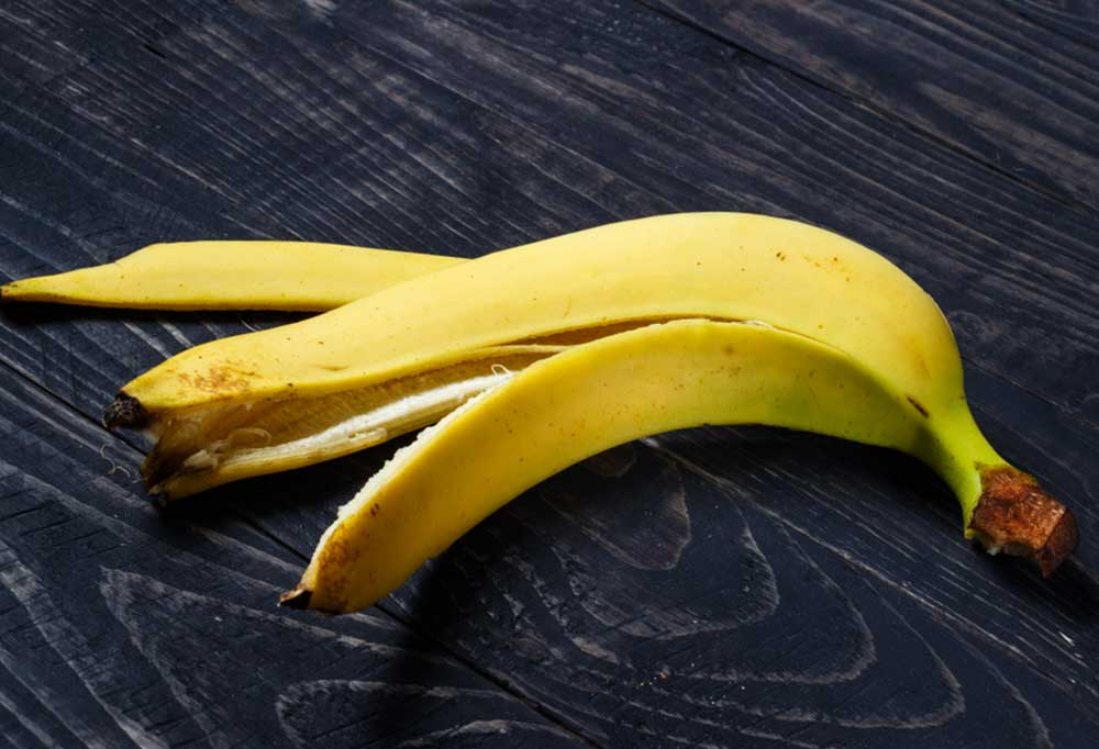 banana peel on dark wood surface