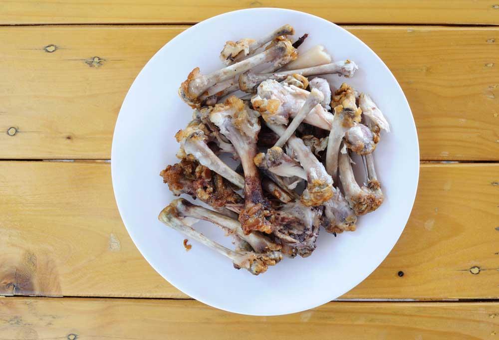 plate of chicken bones