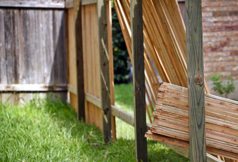 privacy fence being built