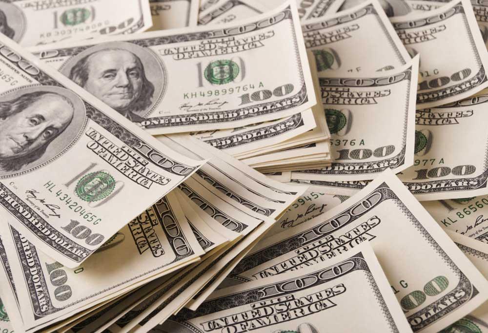 Close up a pile of 100 dollar bills