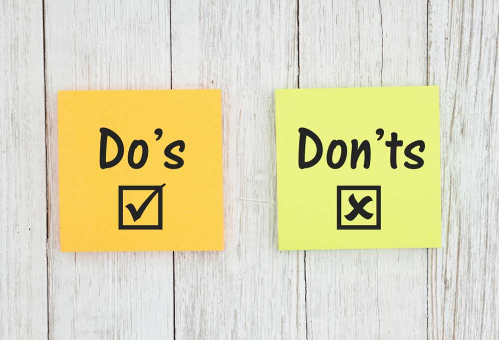 2 yellow post its that read Do's and Don't with check boxes stuck to a gray wood panel