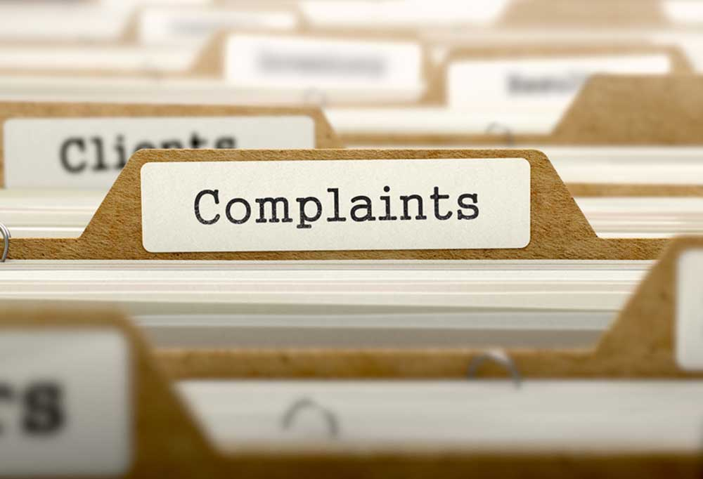 """files in a cabinet with """"Complaints"""" on one of the tabs"""