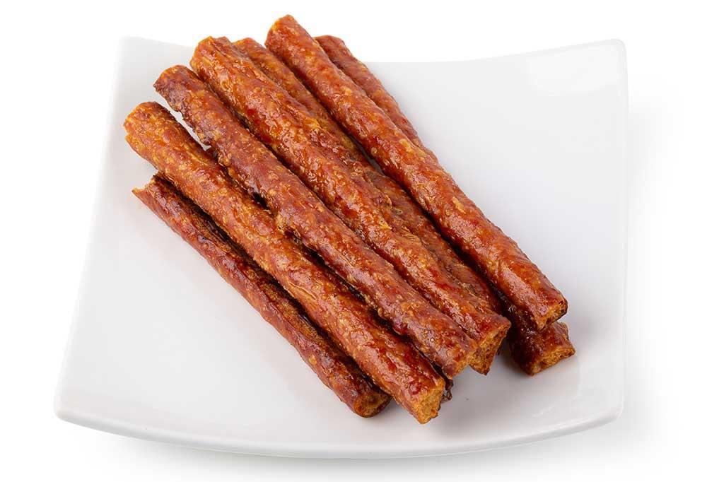 Beef jerky sticks on a white plate