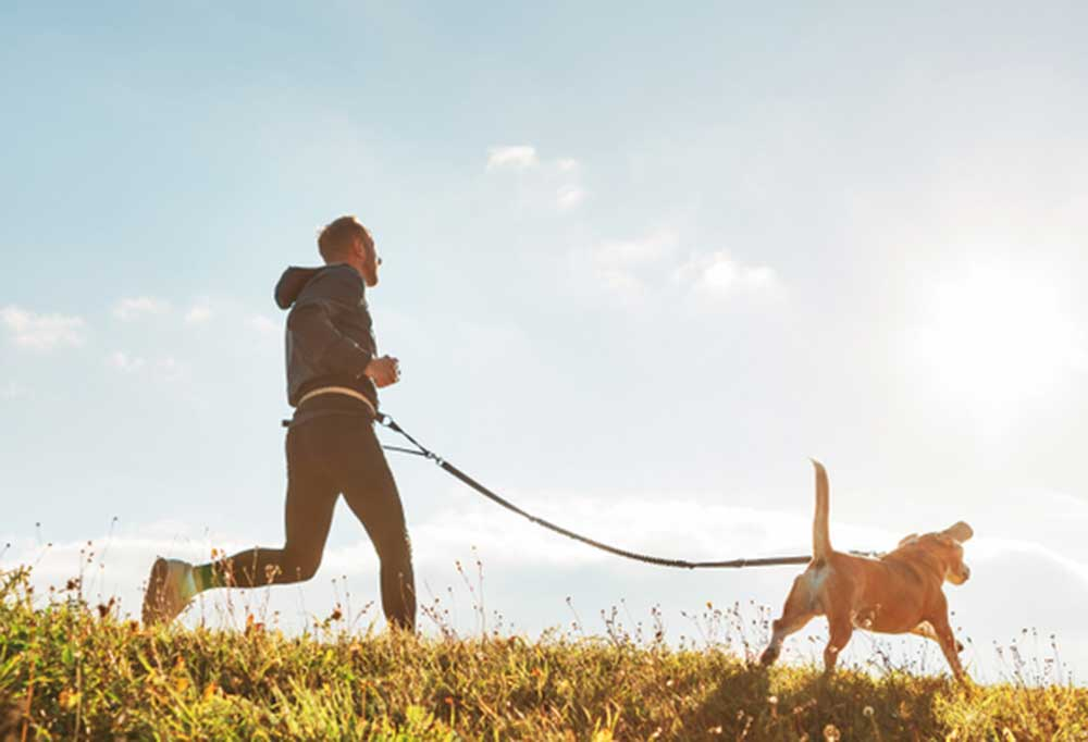 Man running with dog for exercise