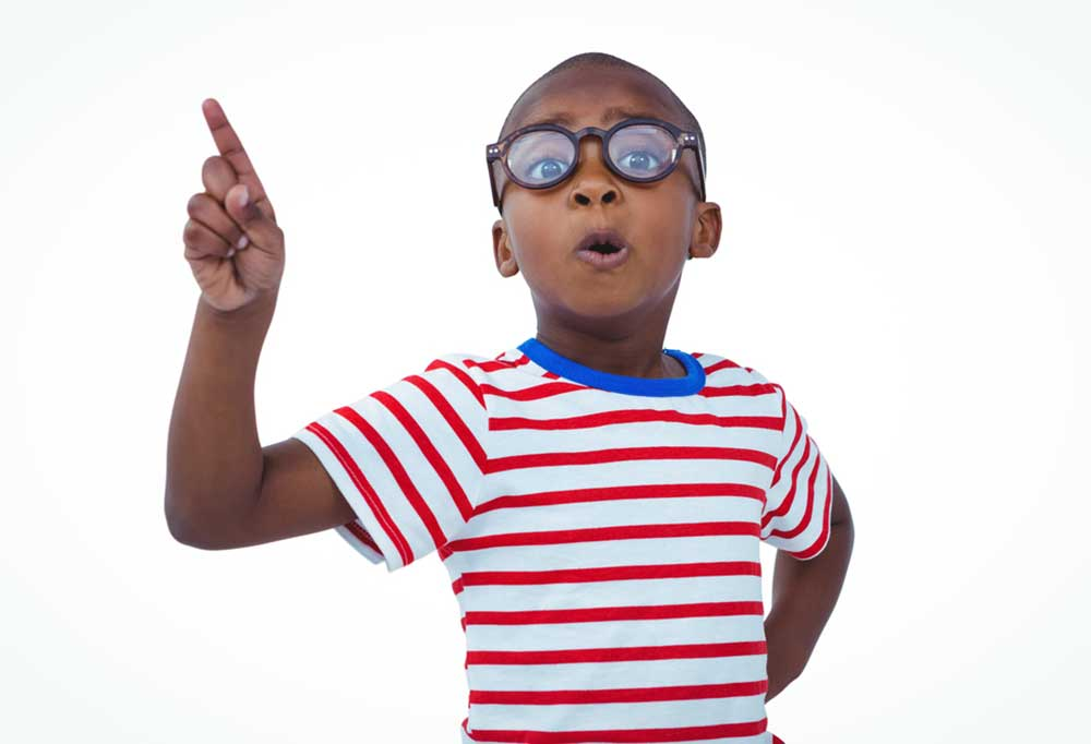 """Small boy in glasses and a red and white striped shirt wagging his finger """"no"""""""