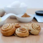 cinnamon rolls on a floured pastry board