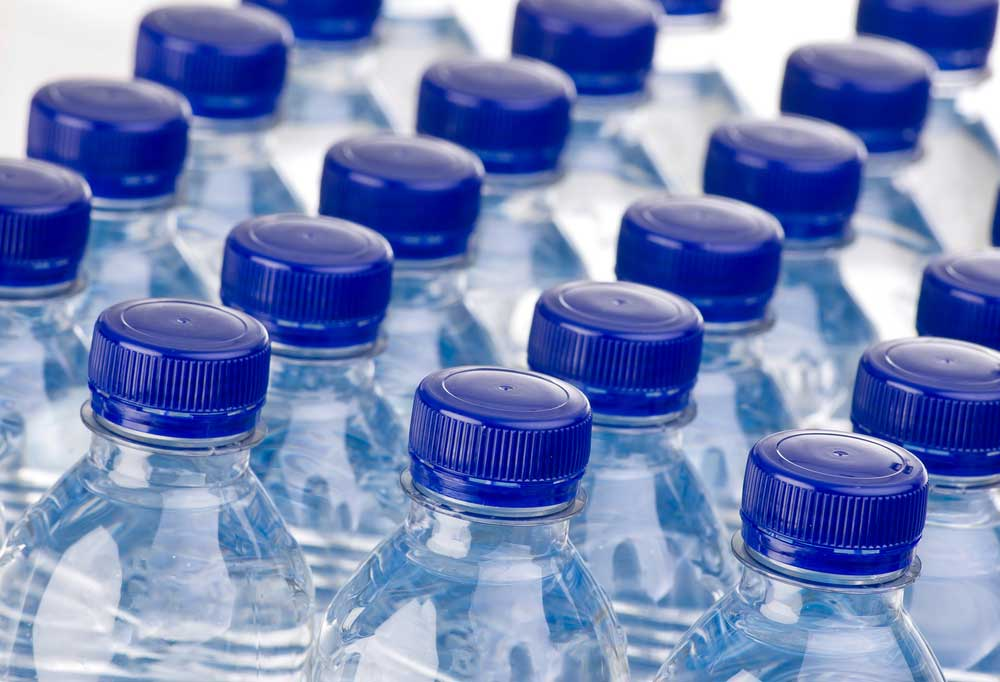 Cap view of lined up water bottles