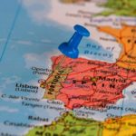 Map with blue thumb tack in Portugal