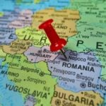 Map with red thumb tack in Romania