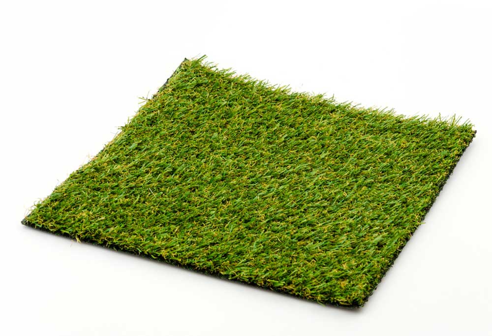 Square of fake grass on a white background.