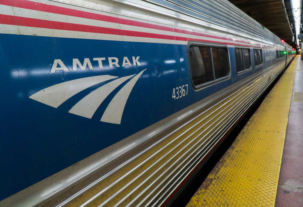 Close up of the side of an Amtrak train.