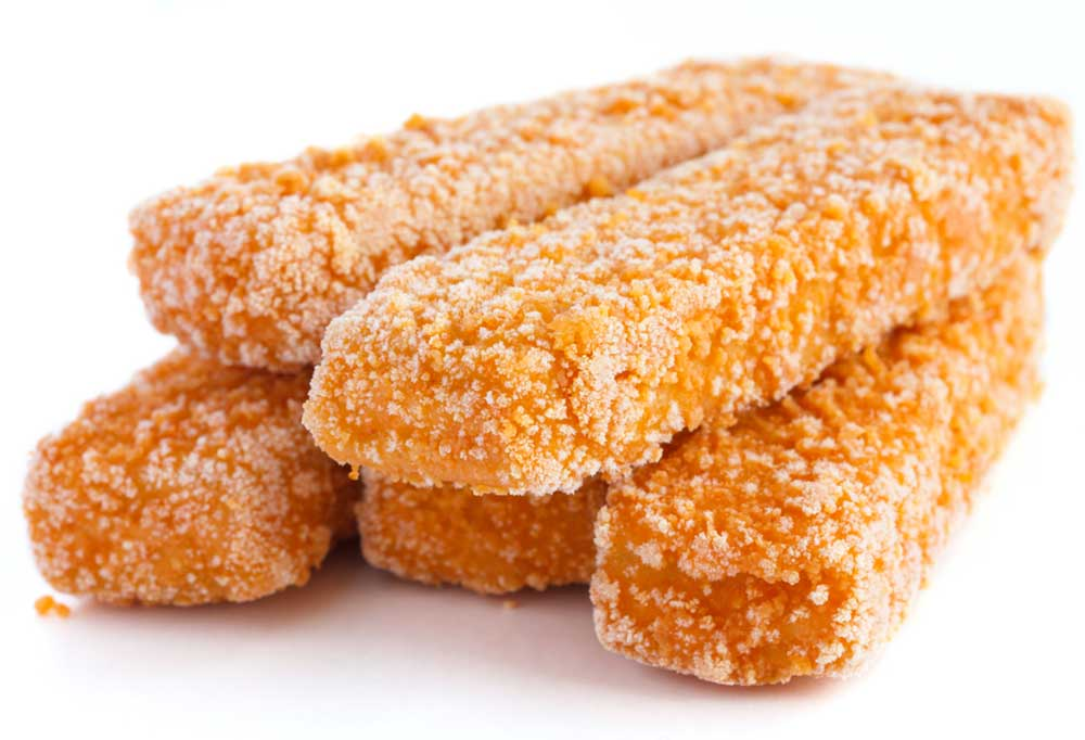 Frozen fish sticks with frost on them isolated on a white background