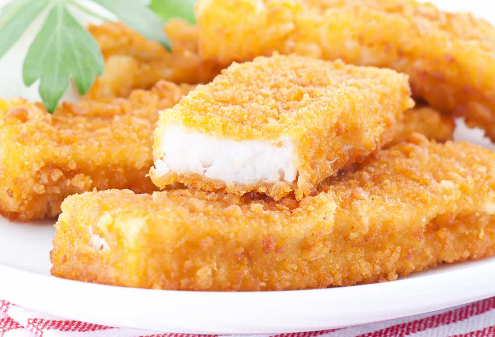 Wide rectangle fish stick on a white plate