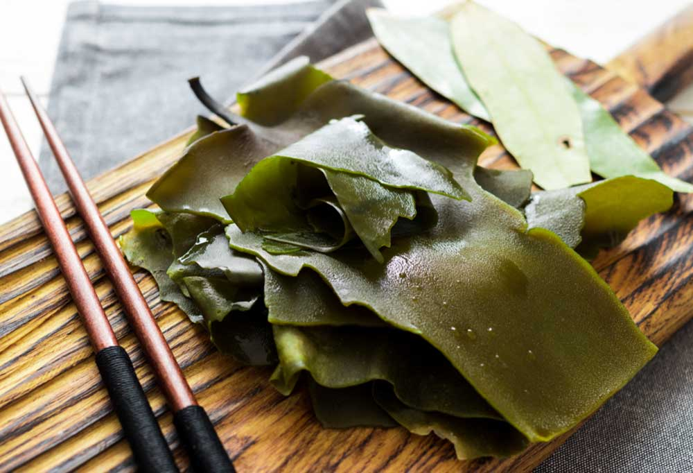 Kelp on a wooden plank with chop sticks