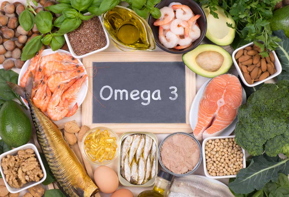 """variety of different foods surrounding a sign that says """"Omega 3"""""""
