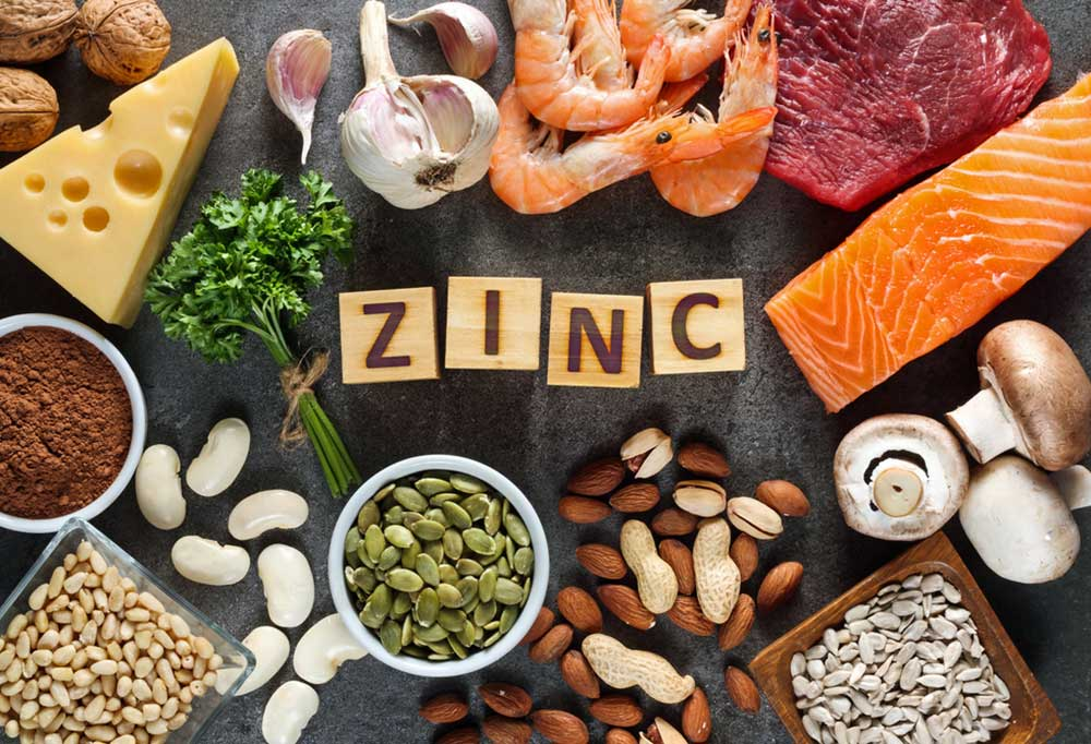 Zinc rich foods surrounding wooden blocks spelling out the word Zinc